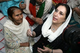 Bhutto, right, was put under house before she could lead a rally against Musharraf [AFP]