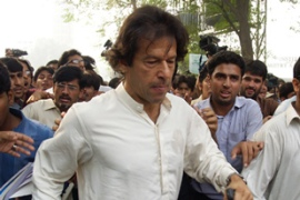 Khan has been a bitter critic of Musharraf and his emergency rule [AFP]