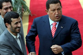 Chavez, right, hailed Iran's 'dignity' and pledged to stand by Iran against any US action [EPA]