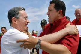 Chavez, right, says commercial ties which the leaders fostered are now under threat [AFP]