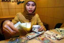 Global Islamic finance industry is said to be growing at 15 per cent every year [EPA]