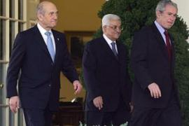 Bush met Olmert, left and Abbas, centre, separately before holding three-way talks [AFP]