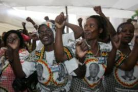 Zanu-PF supporters shout slogans praising Mugabe after the approval [AFP]