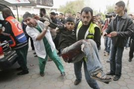 Palestinians rush a wounded to the hospital [ Reuters]
