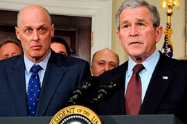 Paulson, left, moved to support the ailing lenders after Bush passed a housing act [AFP]