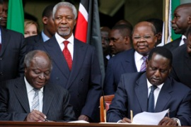 power-sharing deal between Kibaki, left, and Odinga was brokered by Kofi Annan [EPA]
