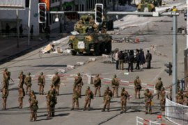 Witnesses said tanks, armoured vehicles and troops were deployed on the streets of Lhasa [AFP]