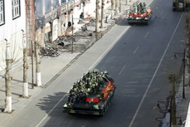 Chinese security forces are reported to be conducting house to house searches in Lhasa [AFP]