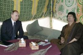 Vladimir Putin, Russia's prime minister, left, visited Libya in April [AFP]