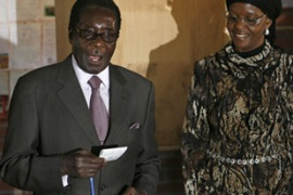 Mugabe rejected international calls to postpose the run-off election [AFP]