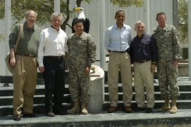 Obama received a military briefing at the Bagram air base after his arrival [AFP]