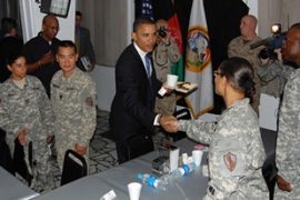 Obama met US troops at a military base in Kabul on the first day of his tour [AFP]