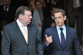A joint statement by Cowen, left, and Sarkozy downplayed tensions between them [AFP]