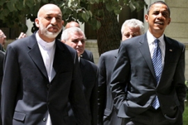 Obama, right, held talks with the Afghanpresident, Hamid Karzai, on Sunday [AFP]