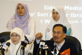 The decision of Wan Azizah Wan Ismail, left, enables Anwar to contest her seat [AFP]