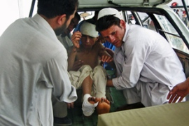Afghan medics carry a boy out of a van after allegedly suffering injuries in Sunday's attack [AFP]