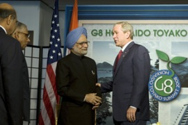 "Singh, left, said he wanted India and the US to stand ""shoulder-to-shoulder"" [AFP]"