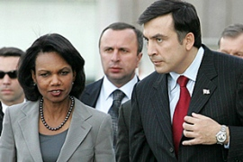 Rice, left, spent five hours with Saakashvili discussing the peace pact [AFP]