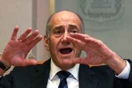 Olmert is alleged to have paid bribes to a US businessman [AFP]