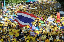 Thousands have surrounded Government House in Bangkok [AFP]