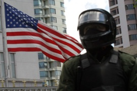 Police stood guard at the US embassy inLa Paz as protesters gathered outside [Reuters]