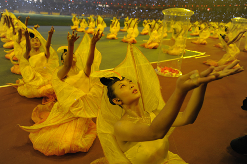 Chinese dancers perform in unison [AFP]