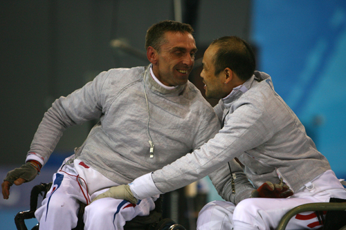 Francois Laurent (L) of France celebrates with Hui Charn Hung of Hong Kong after the sabre gold match [GALLO/GETTY]
