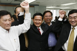Protesters say Somchai, centre, is a puppet of former PM Thaksin Shinawatra [Reuters]