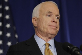 John McCain said Democrats were playing partisan politics over the deal [AFP]