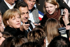 Merkel and Sarkozy have clashed in the past on the correct response to the financial crisis [EPA]