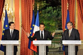 Sarkozy, centre, announced the package at a summit of 15 Eurozone nations in Paris [AFP]