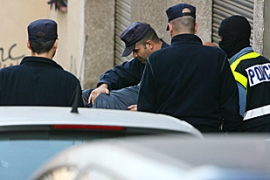 The operation included raids on four towns near Barcelona [AFP]