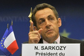 "Sarkozy urged dissenting members not to ""hide behind the crisis"" [AFP]"