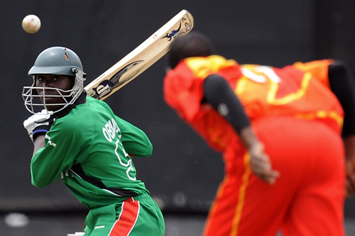 Kenya's David Obuya smashes a Zimbabwe delivery in an Intercontinental four day match in Nairobi [AFP]