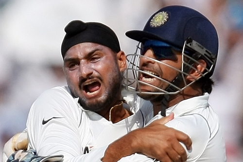 Harbhajan Singh celebrates with captain Mahendra Dhoni after removing Simon Katich on day four [AFP]