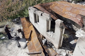 A destroyed house outside Tskhinvali testifies to the magnitude of the reconstruction task [AFP]