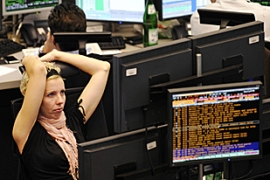 The cut gave a brief boost to UK and European stocks but gains quickly faded [AFP]