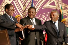 Mbeki, right, brokered the initial deal between Tsvanigrai and Mugabe [EPA]