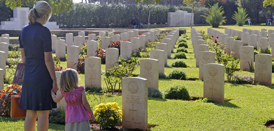 A British woman and her daughter look at graves of about 1,200 casualties of the two world wars at Beirut War Cemetery, Lebanon [EPA]