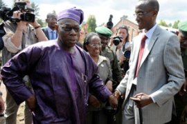 Obasanjo, left, met Nkunda as part of an attempt to mediate between the CNDP and Kinshasha [AFP]