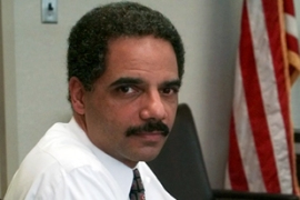 Eric Holder could become the first African-American to head the  US justice department [AP]