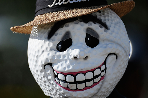 A volunteer wears a Halloween mask during the Ginn sur Mer Classic golf tournament [GALLO/GETTY]