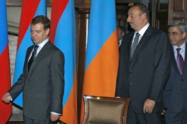 Aliyev, centre, and Sarkisian, right, met  on Sunday in Medvedev's residence near Moscow [AFP]