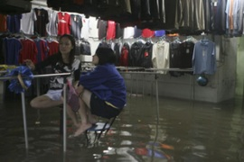 Shops and schools were forced to close after floodwaters rose to chest levels [Reuters]
