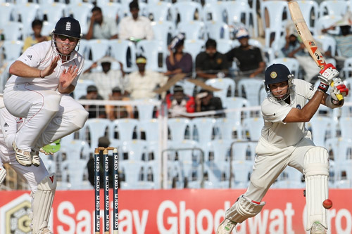 Ian Bell takes evasive action as VVS Laxman has a pop [AFP]