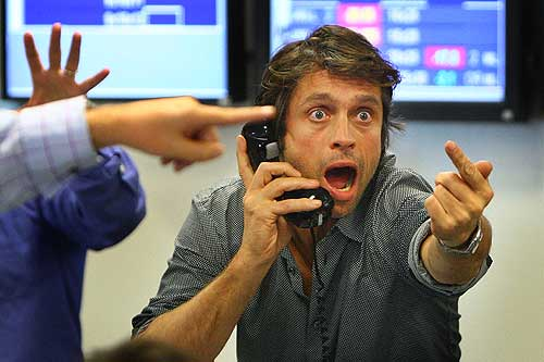 LONDON - OCTOBER 09:  A broker on ICAP''s dealing floor calls for prices on October 9, 2008 in London.  Share prices are up on the day as markets react to the interest rate cut.  (Photo by Peter Macdiarmid/Getty Images)