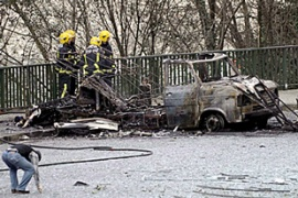 Police said a van parked at the back of the building was used as a car bomb [EPA]