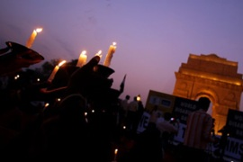 Thousands of people held a vigil opposite the Taj Mahal hotel to remember the dead[AFP]