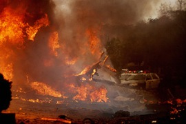 The jet crash sparked a huge inferno in the San Diego neighbourhood [AFP]