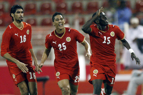 Bahrain's players celebrate after scoring against Iraq [AFP]